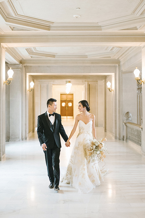 San-francisco-glamorous-wedding-at-city-hall-bride-and-groom-walking-and-holding-hands