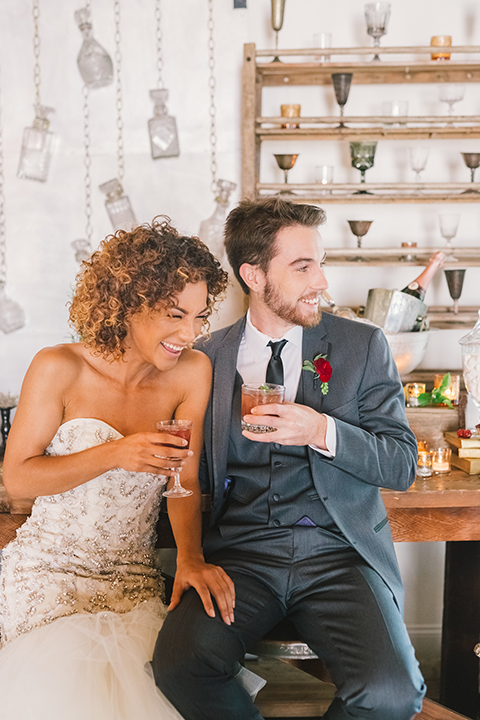 Orange-county-wedding-at-the-colony-house-bride-and-groom-sitting-and-smiling