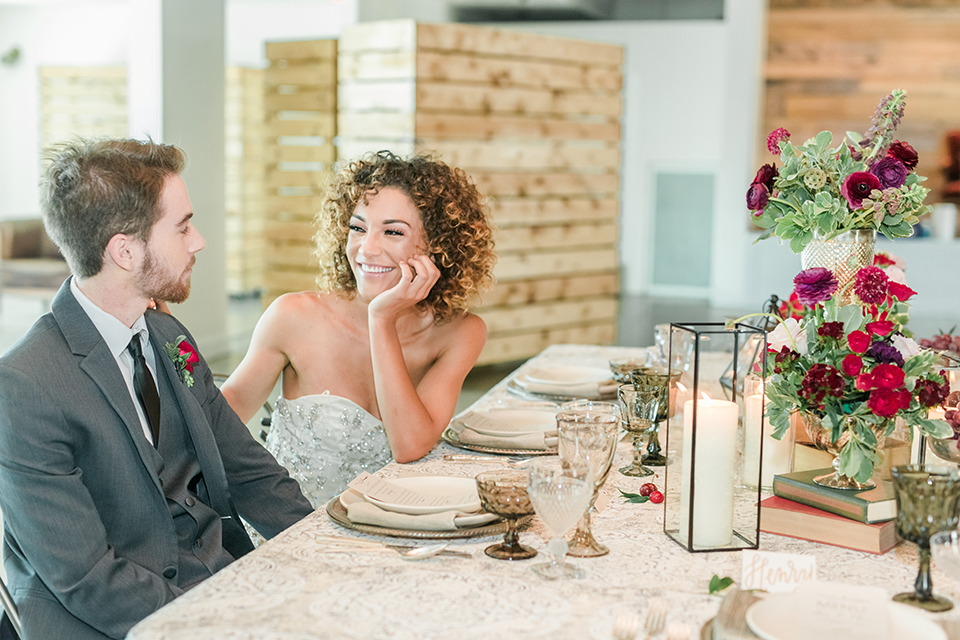 Orange-county-wedding-at-the-colony-house-bride-and-groom-sitting-at-table-smiling