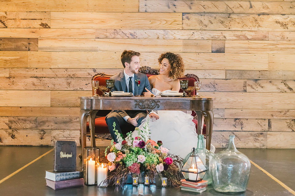 Orange-county-wedding-at-the-colony-house-bride-and-groom-sitting-at-vintage-table