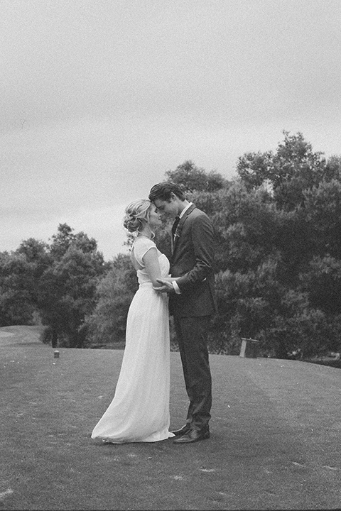 Temecula-stonehouse-wedding-shoot-bride-and-groom-hugging-black-and-white-photo