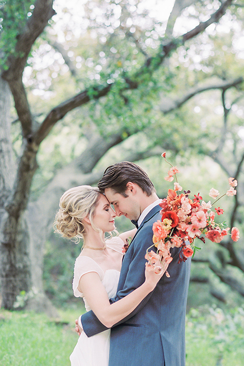 Temecula-stonehouse-wedding-shoot-bride-and-groom-hugging-with-bouquet