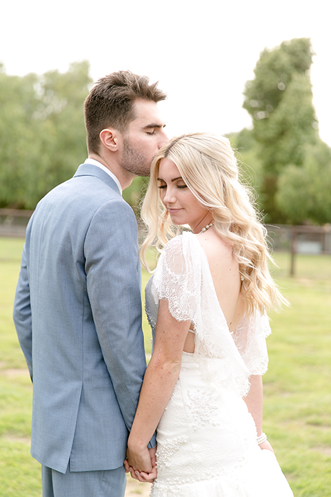 Sweet-oaks-ranch-outdoor-wedding-shoot-bride-and-groom-holding-hands-kissing