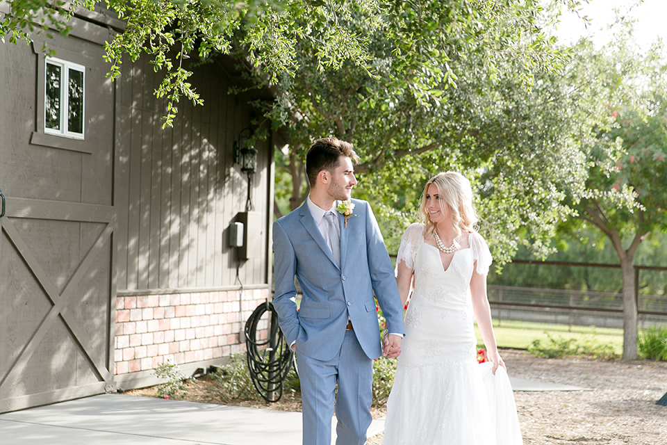 Sweet-oaks-ranch-outdoor-wedding-shoot-bride-and-groom-holding-hands-smiling