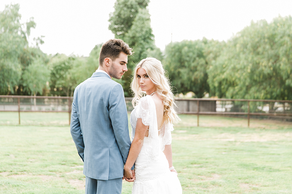 Sweet-oaks-ranch-outdoor-wedding-shoot-bride-and-groom-holding-hands
