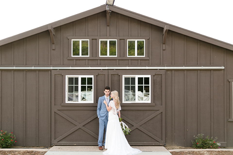 Sweet-oaks-ranch-outdoor-wedding-shoot-bride-and-groom-hugging-far-away
