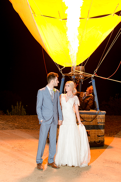 Sweet-oaks-ranch-outdoor-wedding-shoot-bride-and-groom-standing-by-hot-air-balloon