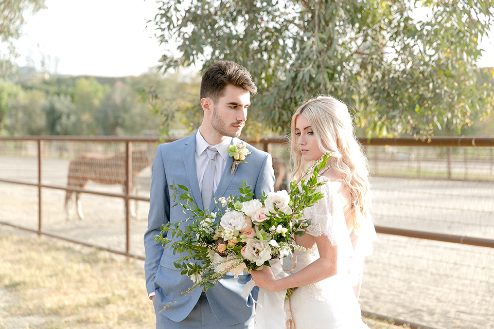 Sweet-oaks-ranch-outdoor-wedding-shoot-bride-and-groom-standing-holding-bouquet