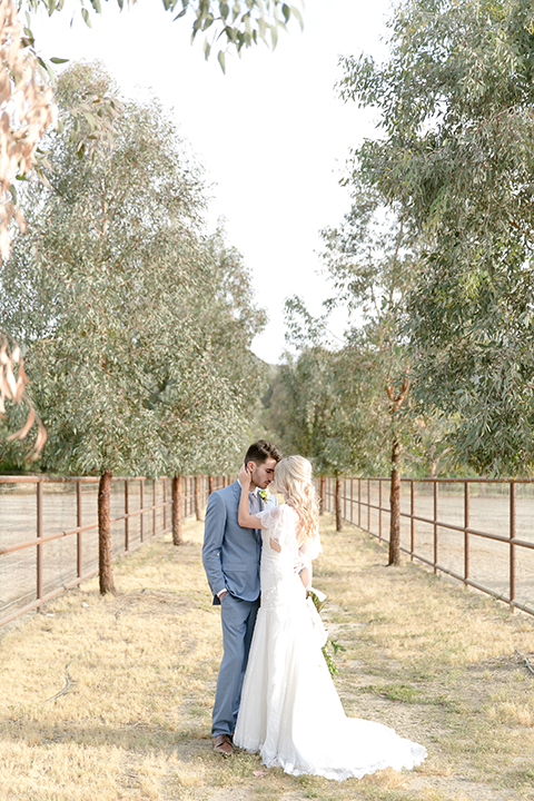 Sweet-oaks-ranch-outdoor-wedding-shoot-bride-and-groom-standing-hugging