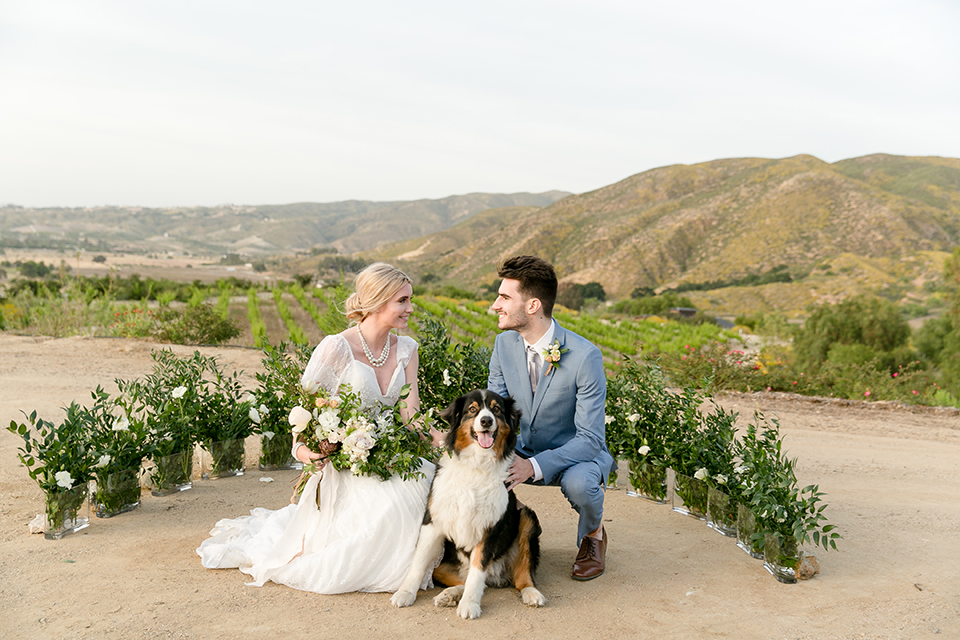 Sweet-oaks-ranch-outdoor-wedding-shoot-ceremony-bride-and-groom-sitting-with-dog