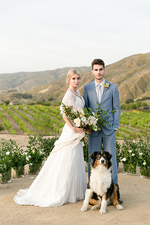 Sweet-oaks-ranch-outdoor-wedding-shoot-ceremony-bride-and-groom-standing-with-dog