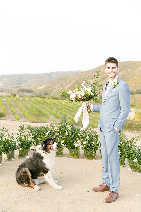 Sweet-oaks-ranch-outdoor-wedding-shoot-ceremony-groom-standing-with-bouquet