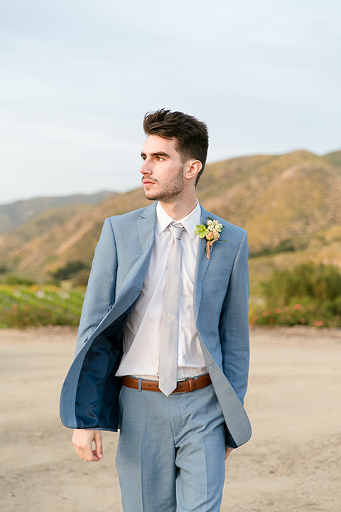 Sweet-oaks-ranch-outdoor-wedding-shoot-groom-blue-suit-walking