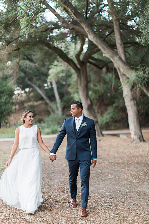 Temecula-outdoor-wedding-bride-and-groom-holding-hands-and-walking