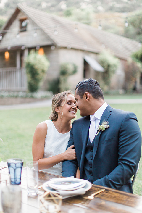 Temecula-outdoor-wedding-bride-and-groom-hugging-and-sitting