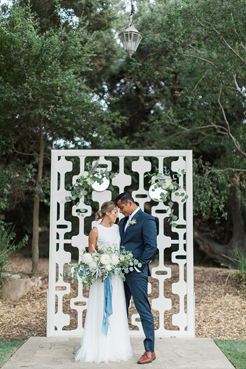 Temecula-outdoor-wedding-bride-and-groom-hugging-ceremony
