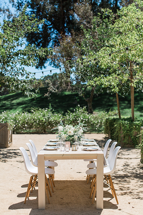 Temecula-outdoor-wedding-table-set-up-with-chairs