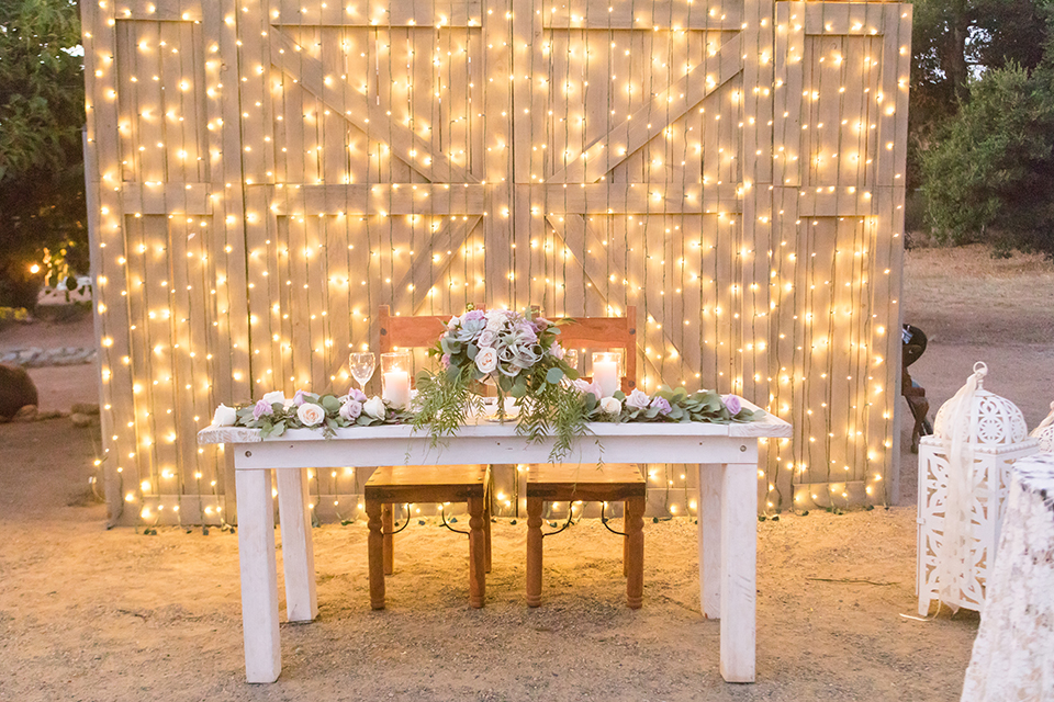 Temecula-outdoor-wedding-at-tres-lagos-table-set-up-with-lights-hanging