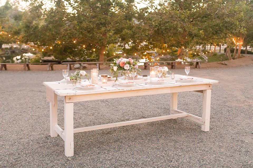Temecula-outdoor-wedding-at-tres-lagos-table-set-up-with-lights
