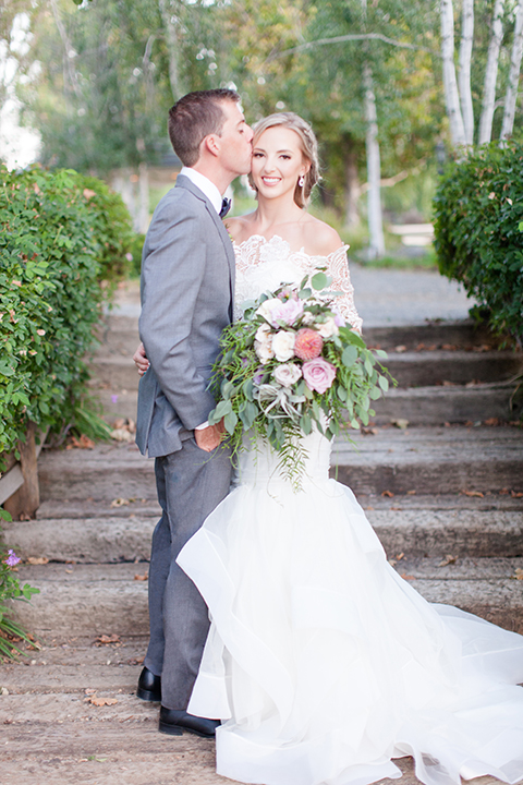 Temecula-outdoor-wedding-bride-and-groom-kissing-close-up