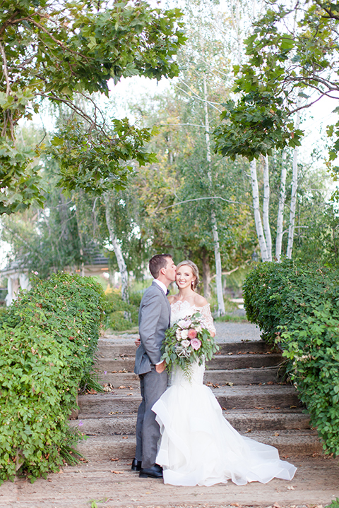 Temecula-outdoor-wedding-bride-and-groom-kissing