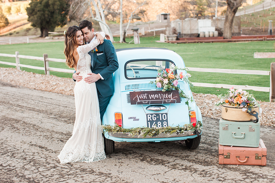 Malibu-wedding-shoot-at-triunfo-creek-vineyards-bride-and-groom-by-car-hugging