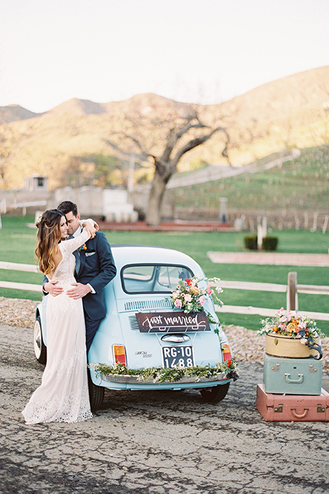 Malibu-wedding-shoot-at-triunfo-creek-vineyards-bride-and-groom-by-car