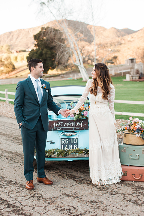 Malibu-wedding-shoot-at-triunfo-creek-vineyards-bride-and-groom-holding-hands-by-car
