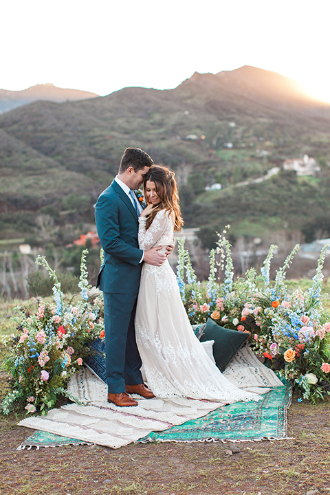 Malibu-wedding-shoot-at-triunfo-creek-vineyards-bride-and-groom-hugging-on-blanket-at-sunset