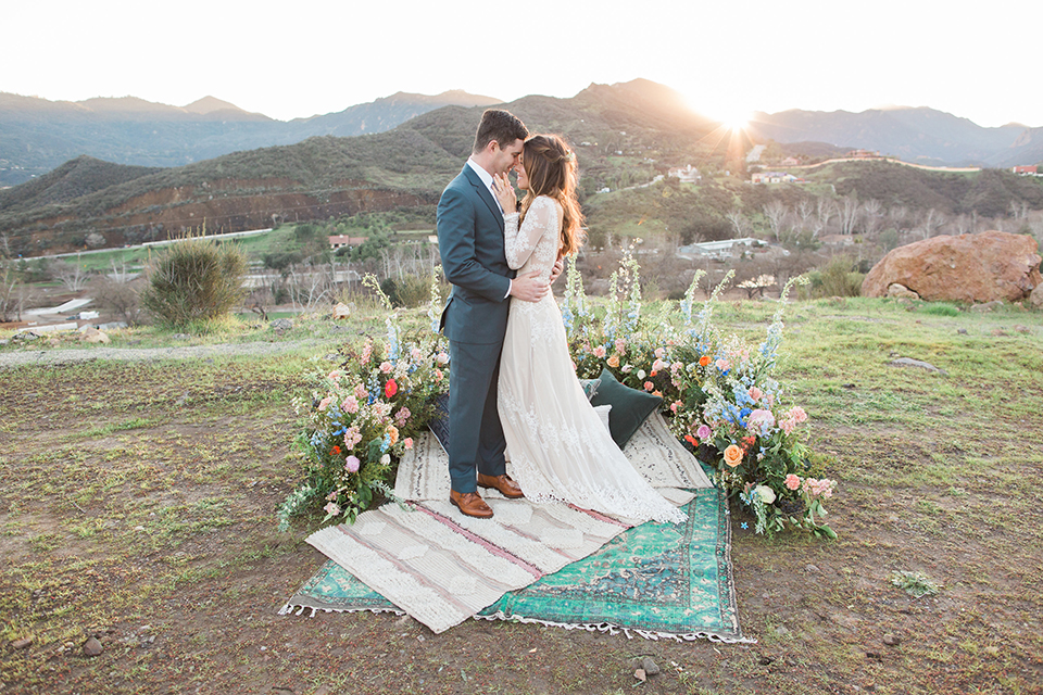 Malibu-wedding-shoot-at-triunfo-creek-vineyards-bride-and-groom-on-blanket-hugging