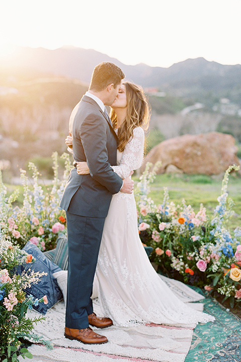 Malibu-wedding-shoot-at-triunfo-creek-vineyards-bride-and-groom-on-blanket-kissing