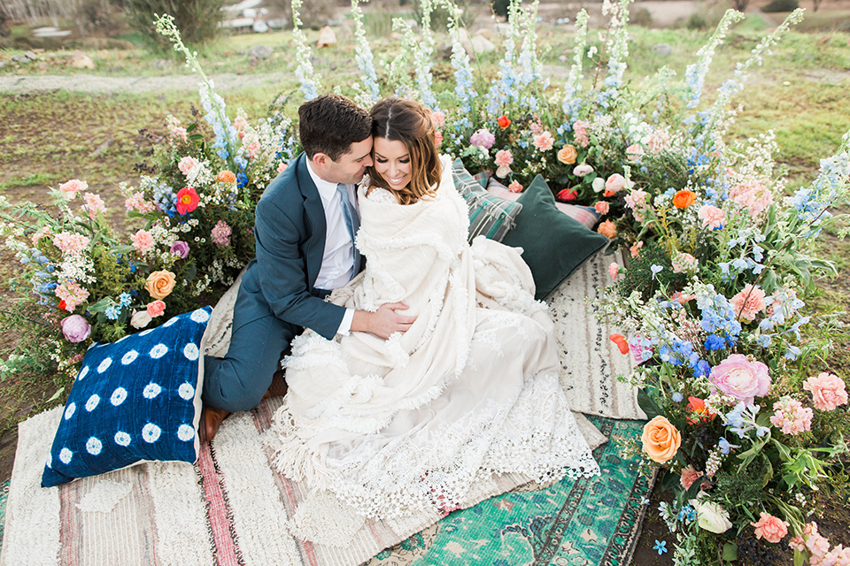 Malibu-wedding-shoot-at-triunfo-creek-vineyards-bride-and-groom-on-blanket-sitting