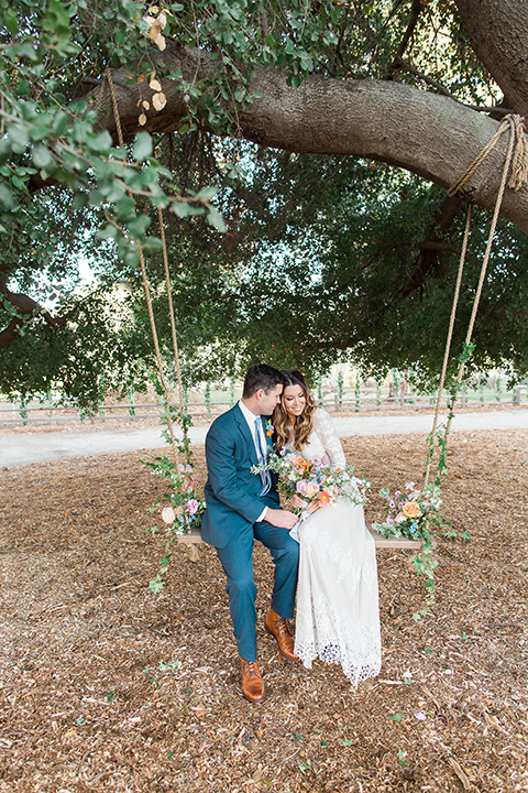 Malibu-wedding-shoot-at-triunfo-creek-vineyards-bride-and-groom-on-swing-far-away