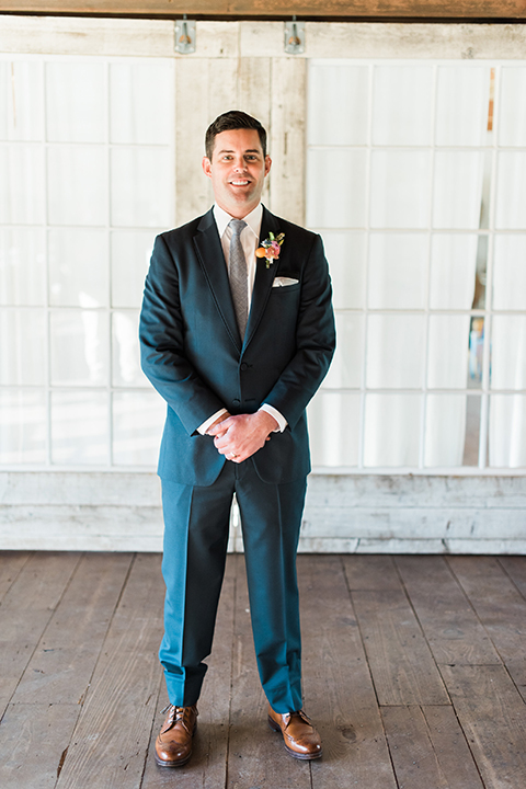 Malibu-wedding-shoot-at-triunfo-creek-vineyards-groom-blue-suit-with-grey-tie