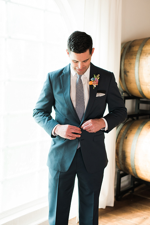 Malibu-wedding-shoot-at-triunfo-creek-vineyards-groom-blue-suit