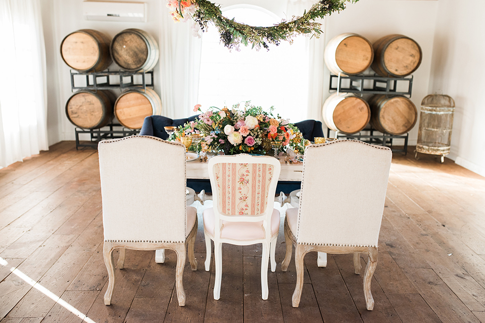 Malibu-wedding-shoot-at-triunfo-creek-vineyards-table-set-up-with-white-chairs