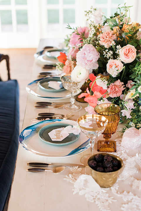 Malibu-wedding-shoot-at-triunfo-creek-vineyards-table-set-up-with-white-place-settings-and-flowers