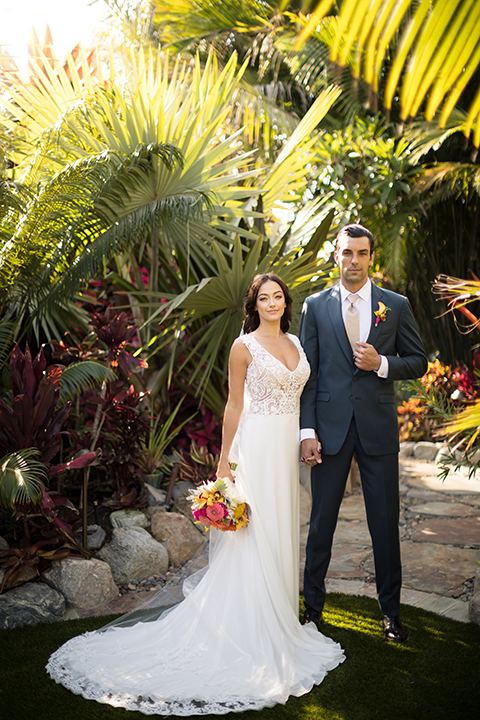 Glamorous-backyard-wedding-shoot-at-a-private-estate-bride-and-groom-standing-and-holding-hands
