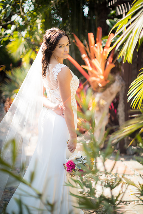 Glamorous-backyard-wedding-shoot-at-a-private-estate-bride-mermaid-style-gown-holding-floral-bouquet