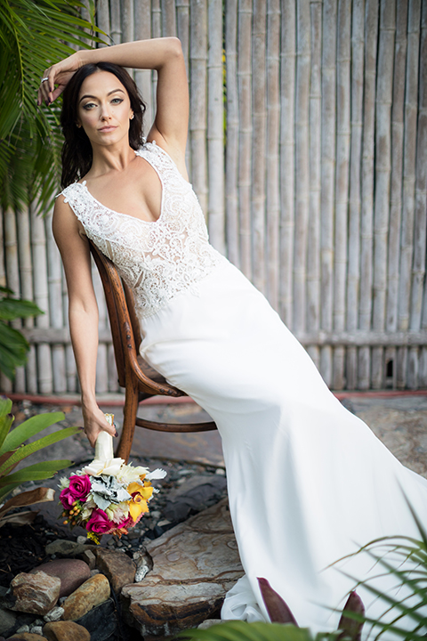 Glamorous-backyard-wedding-shoot-at-a-private-estate-bride-mermaid-style-gown-sitting-on-chair