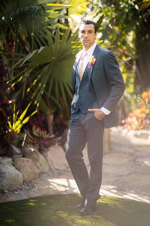 Glamorous-backyard-wedding-shoot-at-a-private-estate-groom-slate-blue-suit-with-long-champagne-tie-and-floral-boutonniere