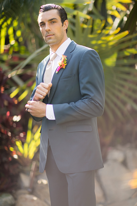 Glamorous-backyard-wedding-shoot-at-a-private-estate-groom-slate-blue-suit-with-long-champagne-tie