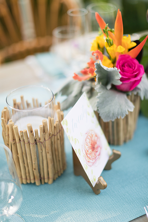 Glamorous-backyard-wedding-shoot-at-a-private-estate-reception-set-up-with-light-brown-wood-table-and-light-blue-linen-with-table-number