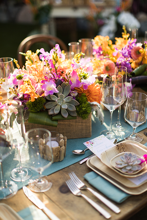 Glamorous-backyard-wedding-shoot-at-a-private-estate-reception-set-up-with-light-brown-wood-table-and-light-blue-napkin-decor