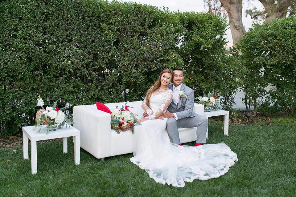 Northern-california-wedding-shoot-at-fitz-place-bride-and-groom-sitting-on-couch