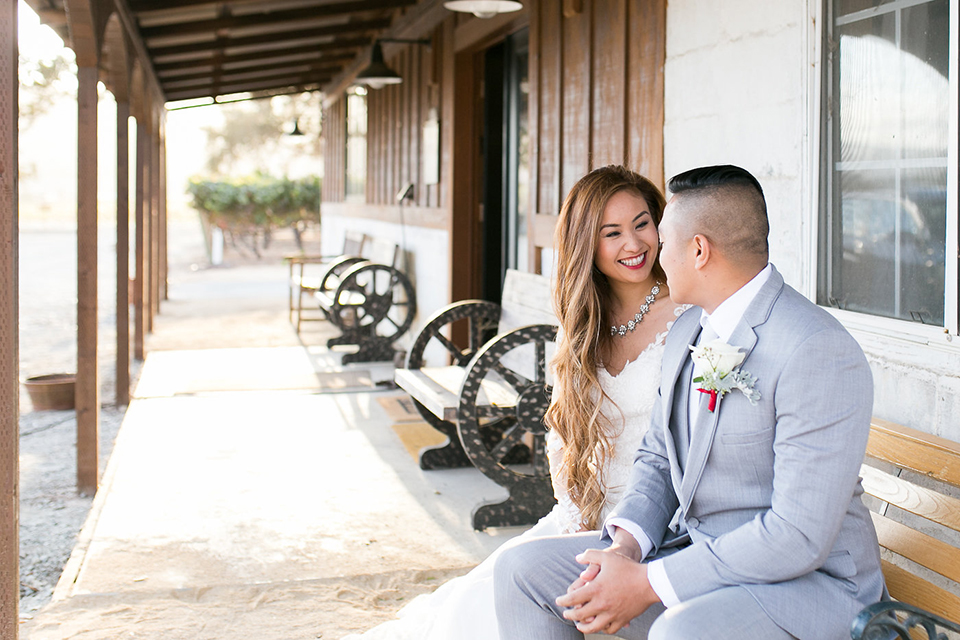 Northern-california-wedding-shoot-at-fitz-place-bride-and-groom-sitting-smiling