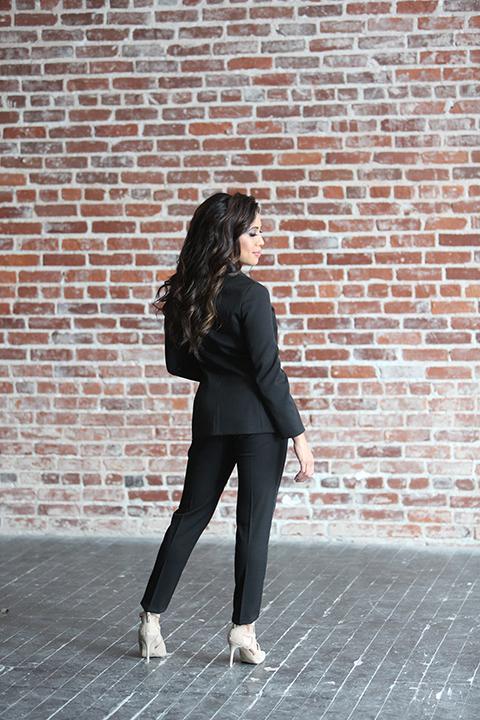 Womens-tuxedo-styled-shoot-at-franciscan-gardens-bride-black-tuxedo-standing-back