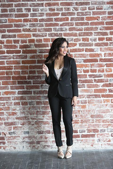 Womens-tuxedo-styled-shoot-at-franciscan-gardens-bride-black-tuxedo-standing-holding-hair