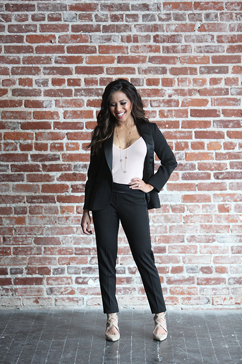 Womens-tuxedo-styled-shoot-at-franciscan-gardens-bride-black-tuxedo-standing-with-hand-on-hip