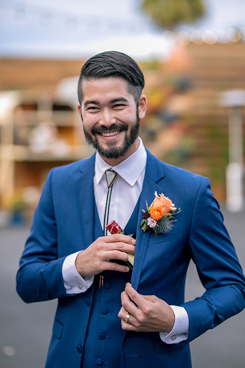 lot-8-colorful-romance-shoot-groom-with-jamerson-groom-in-a-cobalt-suit-with-orange-florals-and-a-bolo-tie